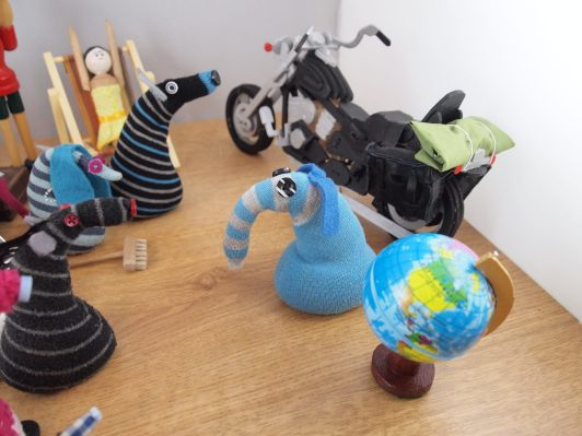 Arnold has got his motorbike and his globe out.
