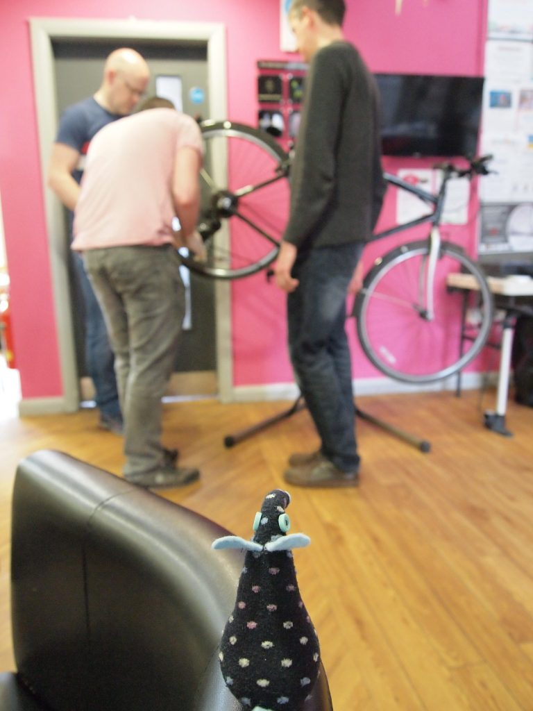 Winston watches a bike being repaired