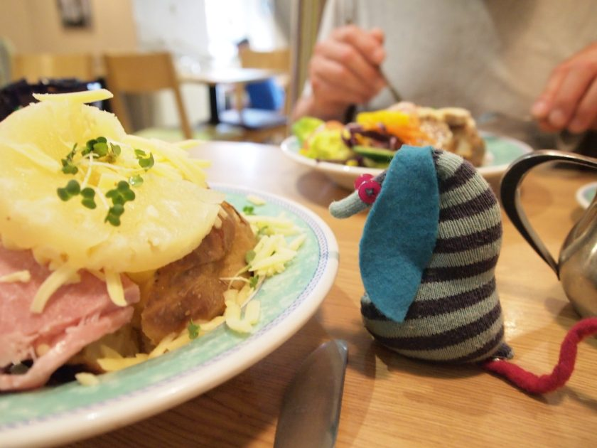 Ofelia looks at a jacket potato in a cafe