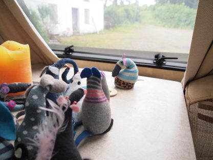 Aloysius shows the vaarks a rural view from a caravan window