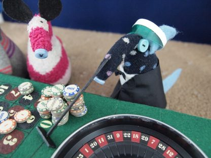 The croupier pulls in the losing chips