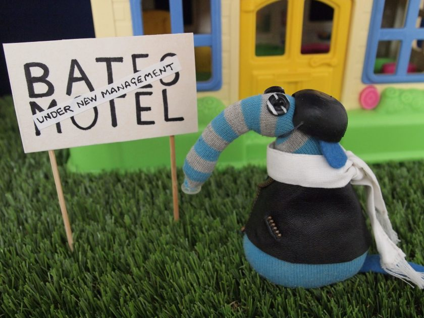 Arnold reads the sign, which says Bates Motel, Under New Management