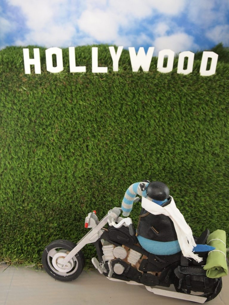 Arnold rides past the Hollywood sign