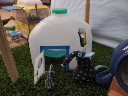 Microvaark looks at his pod, which is the top half of a 6 pint plastic milk bottle with a door cut in it.