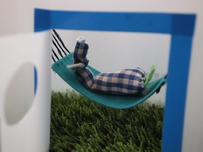 Inside the milk bottle, Microvaark lies on a hammock