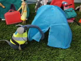 Ernest pulls aside the flap of a pop up tent