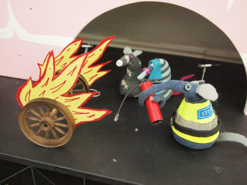 Ernest chases the flaming wheels across the stage
