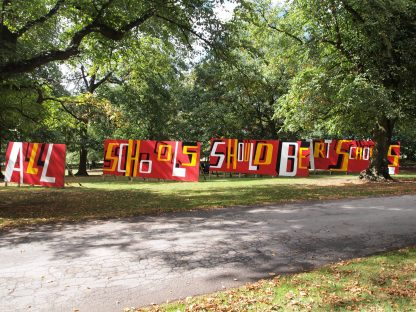A sculpture made of boards reads All Schools Should be Art Schools