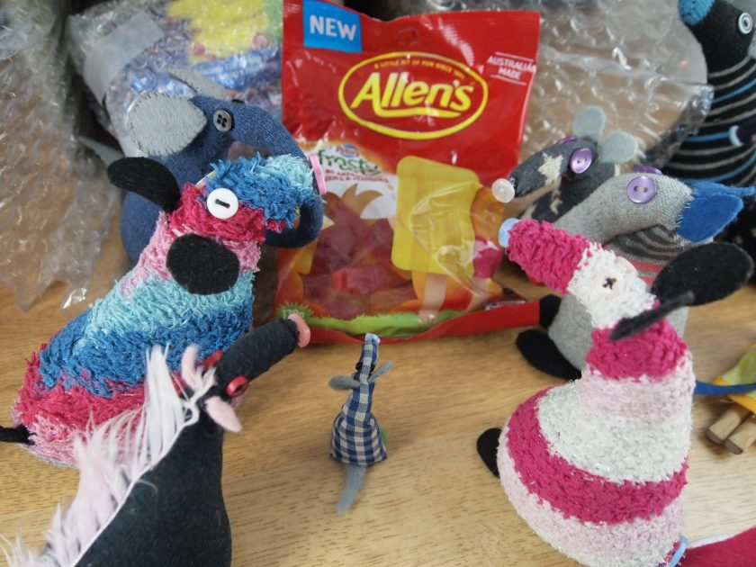 The vaarks look at a bag of fruit flavoured jelly sweets