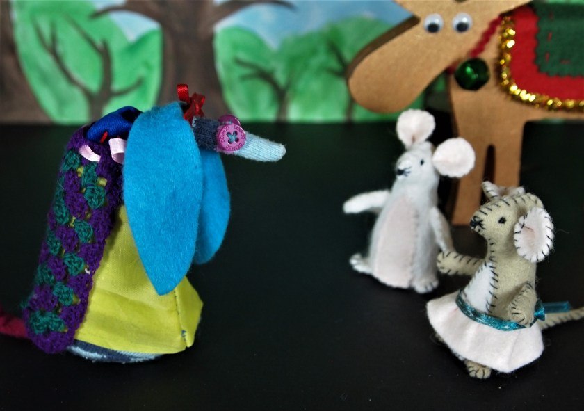 Snow White talks to 2 mice and a moose in the forest
