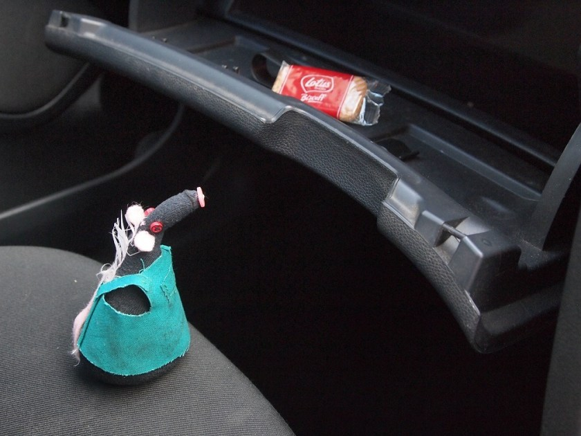 Fury looks at the glovebox, with a biscuit in it