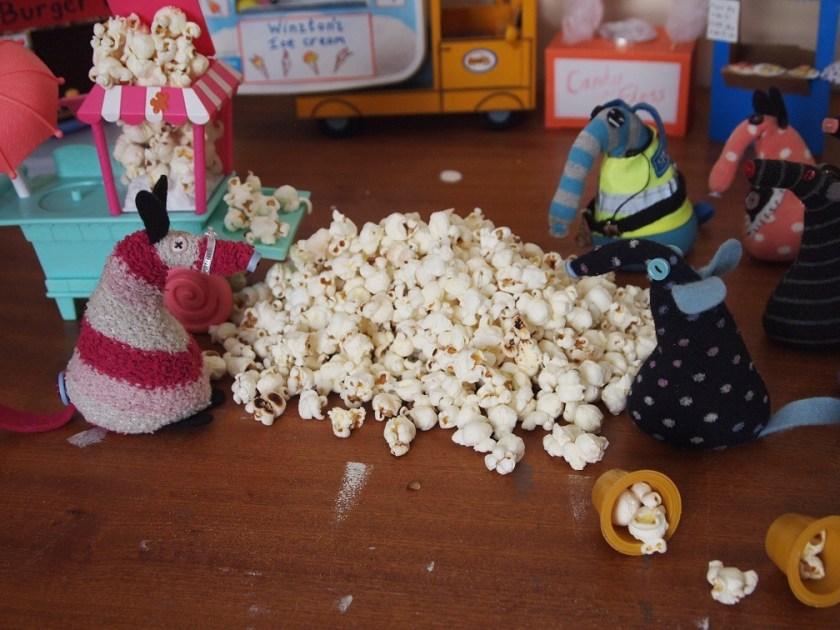 everyone looks at the huge pile of popcorn
