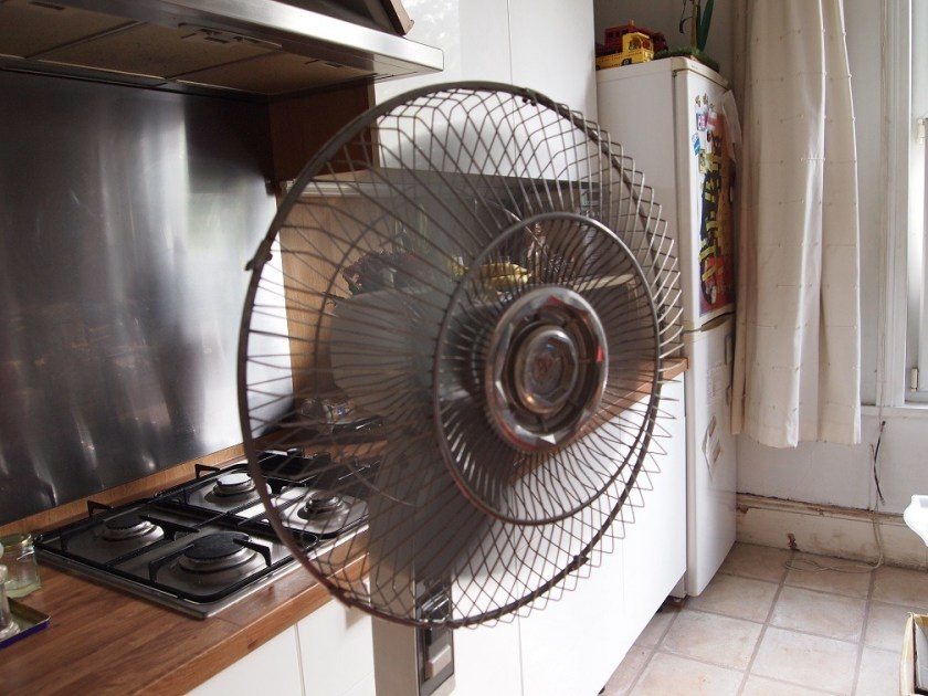 A big electric fan is switched on