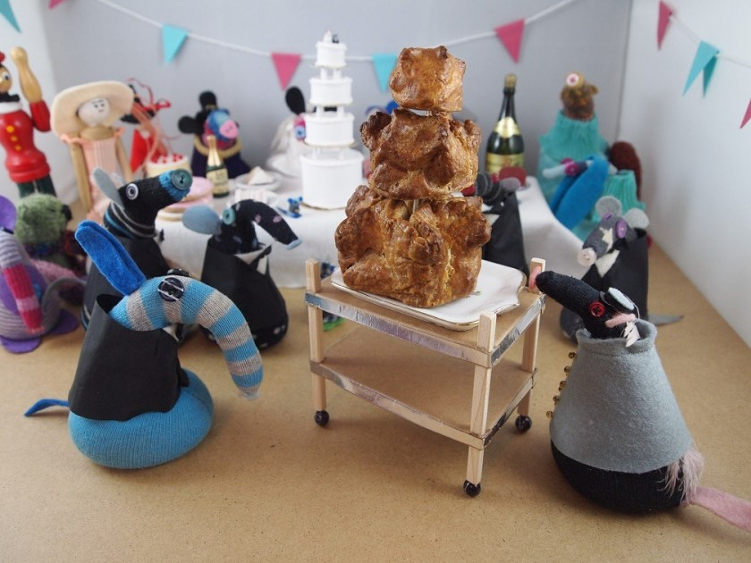 Fury returns with a trolley on which is a trio of hand raised pies in a tower to Arnold's astonishment