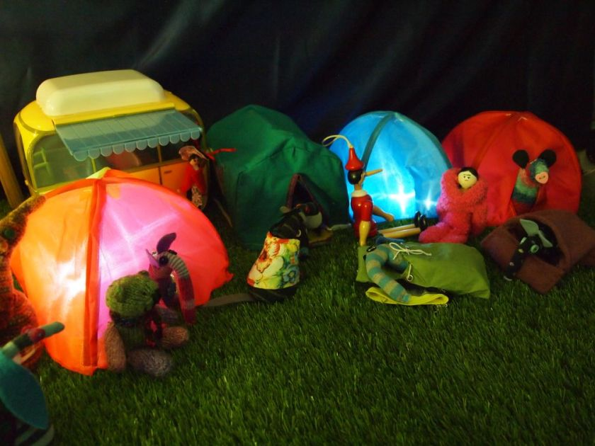 the vaarks are in their tents, illuminated by fairy lights