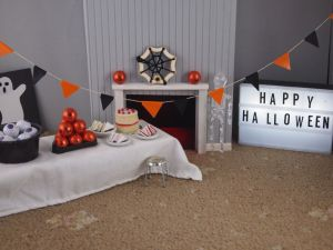 The vaark parlour is set up for a halloween party with bunting, pumpkins etc.