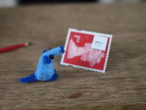 Nano has stuck the tiny envelope in the corner of the stamp