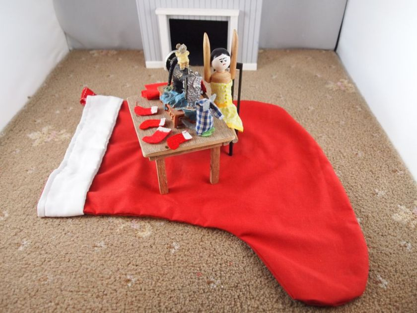 Micro points to the floor and the red rug is revealed to actually be a huge red and white stocking.