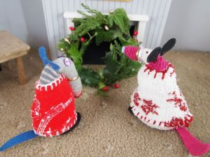 Dim and Matilda step back to look at the wreath