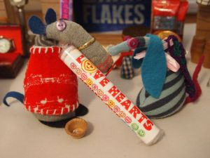 Dim buys a packet of Love Heart Sweets from Ofelia