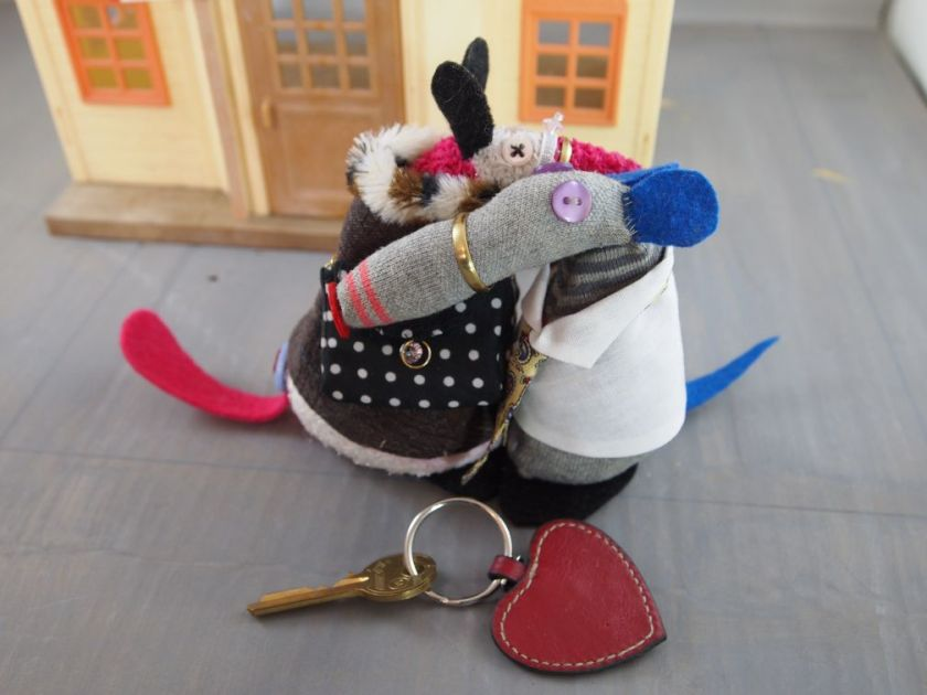 The key is now attached to a heart shaped keyring, as Dim and Matilda hug each other.