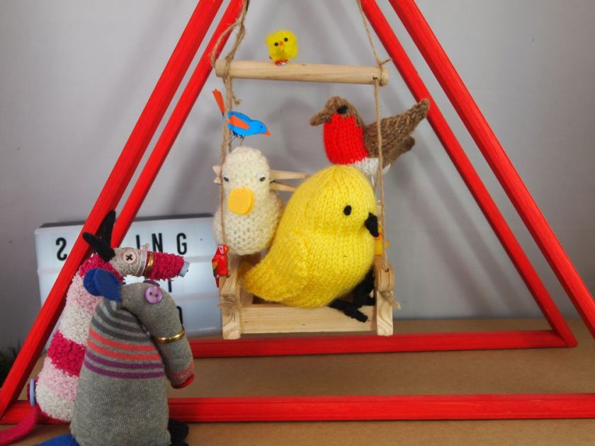 Dim and Matilda back away as a huge knitted canary appears and all the birds take over the swing