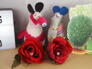 dim and matilda have a pair of red roses