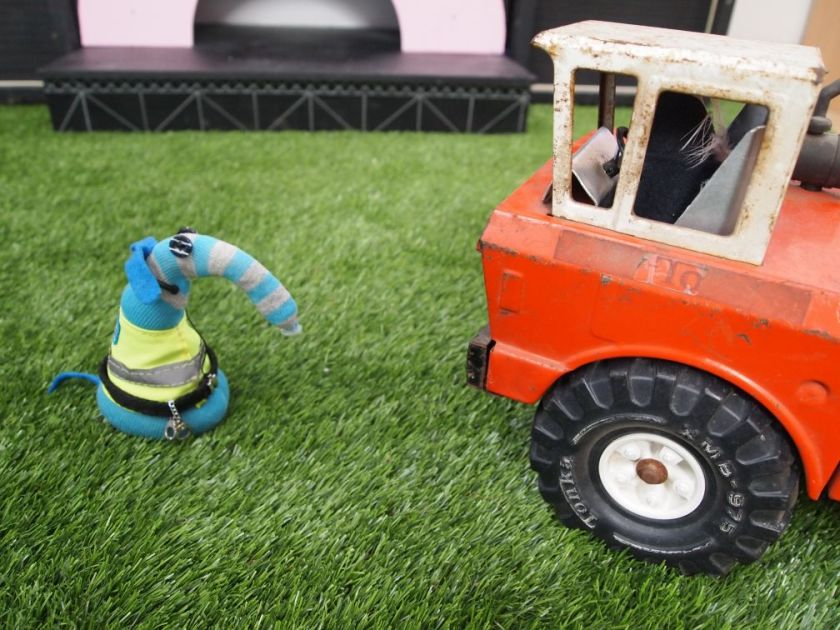 Arnold talks to Fury driving her big truck on an astroturf field.