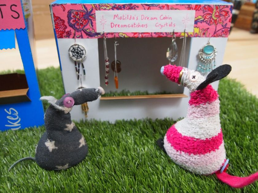 Matilda admires her stall selling dreamcatchers and crystals