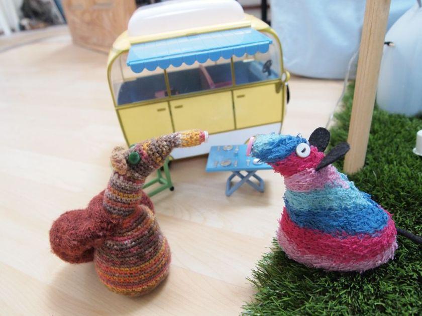 Ratvaark talks to Ester beside the van