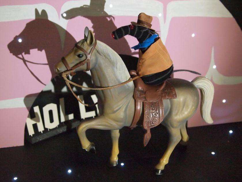 Bernard arrives on stage on a horse in Western gear