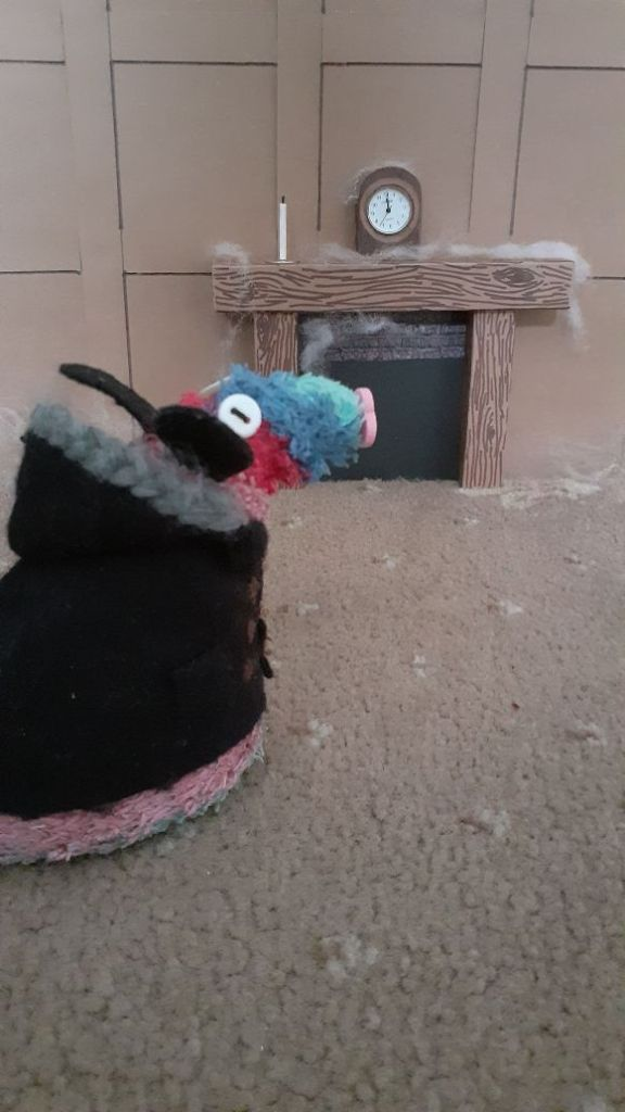Ratvaark is in his duffel coat, in a wood panelled room, with cobwebs and a clock at nearly midnight