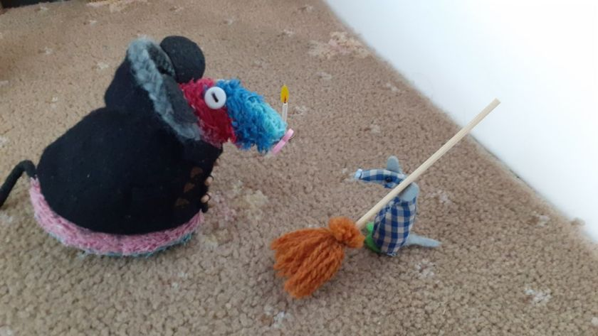 Ratvaark talks to Microvaark, who is carrying a broom