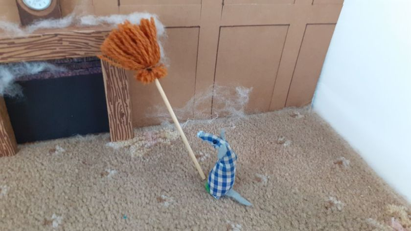 Microvaark uses the broom to sweep some of the cobwebs