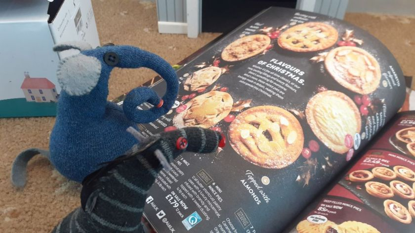 Ernest looks at a page of mince pies