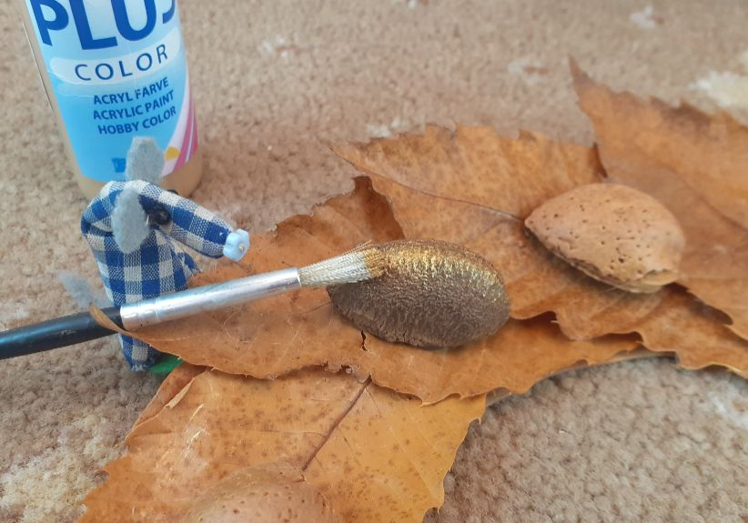 Microvaark brushes a little gold paint on the nuts