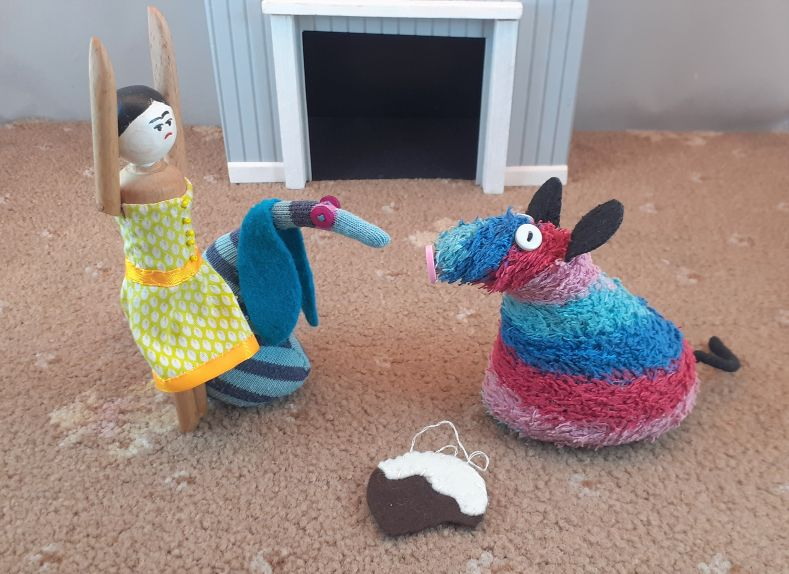 As ratvaark explains, Peggy throws her arms in the air.