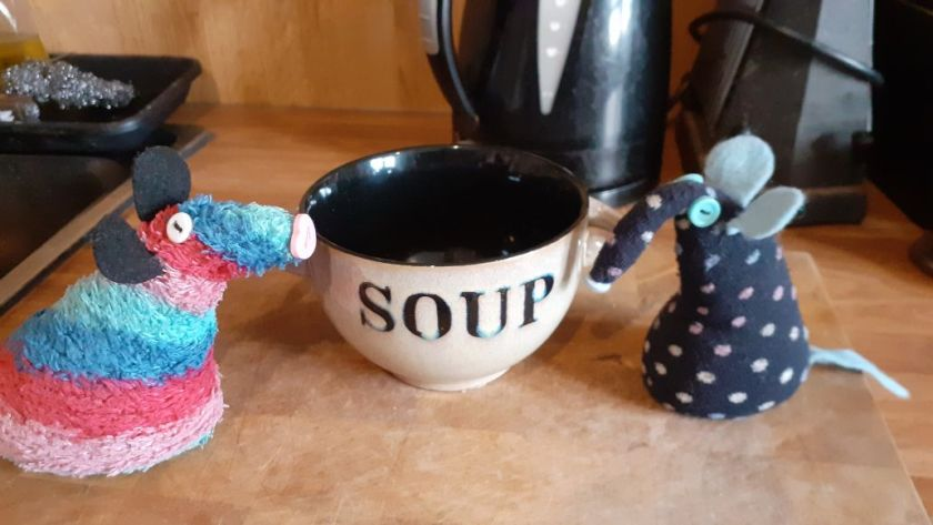 The bowl is turned round to reveal the word Soup.