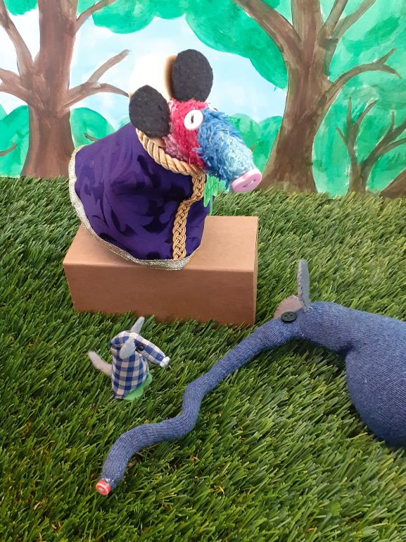 The snake is revealed to be Ernest's long snozzle as he lies asleep beside the stage