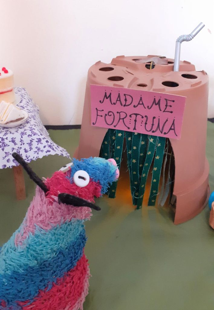 Ratvaark looks at the flowerpot house that is usually Ofelia's falafel stall