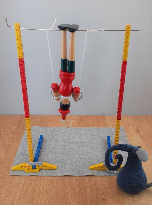 gino is doing a handstand on the rings