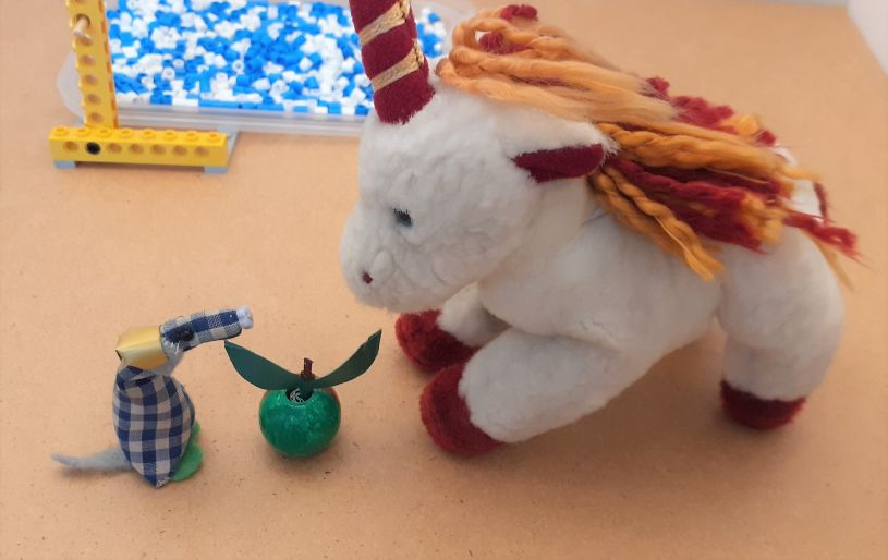 Micro gives his unicorn a green apple