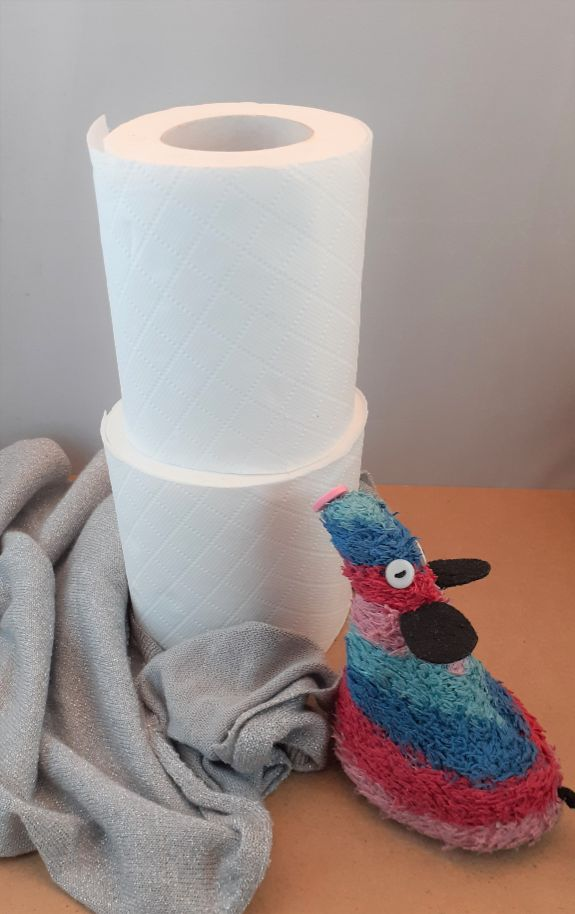 with the covering removed, it is revealed as two toilet rolls stack one on top of the other