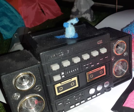 Nano sits on his ghetto blaster on the edge of the dance floor