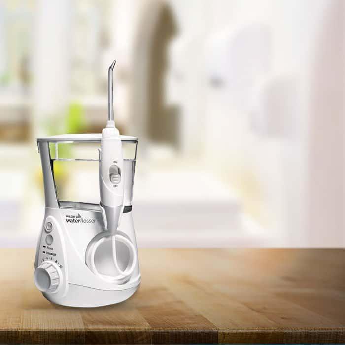 Waterpik water flosser on bathroom counter