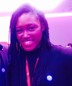 Author, Izzy Obeng wearing her Movemeback badge with pride at the TEDxEuston Salon