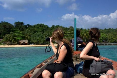 In a boat, pulling up to Koh Totang, Cambodia