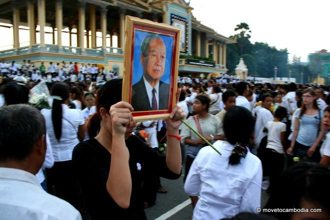 A Cambodian woman carrying a photo of Norodom Sihanouk