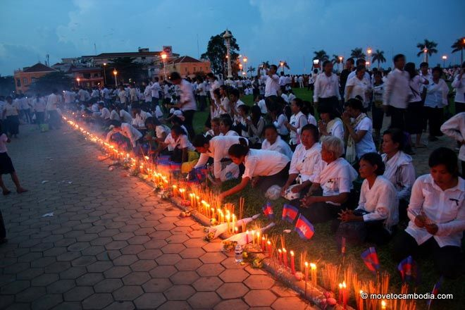 A row of flags, candles and joss sticks to commemorate King Father Norodom Sihanouk