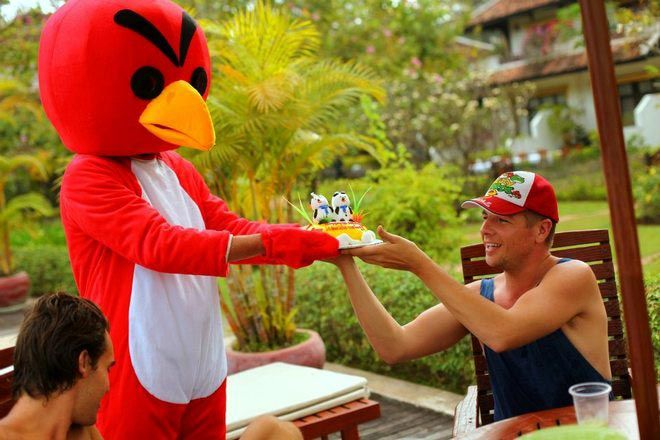 Andy receiving a birthday cake from an Angry Bird